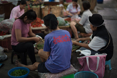 Sellers at work in a vegetable market, Bangkok, Thailand. November 23, 2017. Photo by Lorelei Trammell.