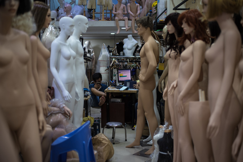 A mannequin seller sits among his wares in Ho Chi Minh City, Vietnam. December 26, 2017. Photo by Lorelei Trammell
