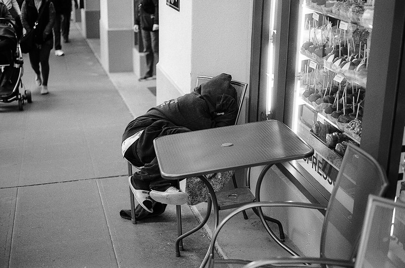 Sleeping in a chair near the candy shop