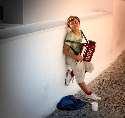 Boy begging for money in Greece