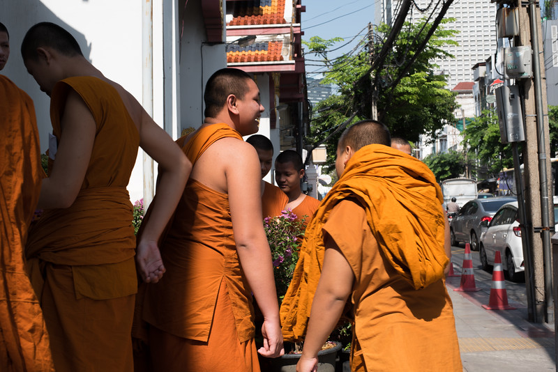 Young monks hang out outside Wat Yannawa in Bangkok, Thailand. December 19, 2017. Photo by Lorelei Trammell.