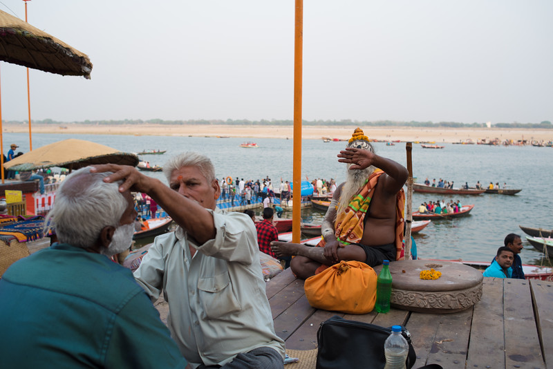 A sadhu prevents me from photographing his face. Varanasi, India. April 1, 2018. Photo by Lorelei Trammell