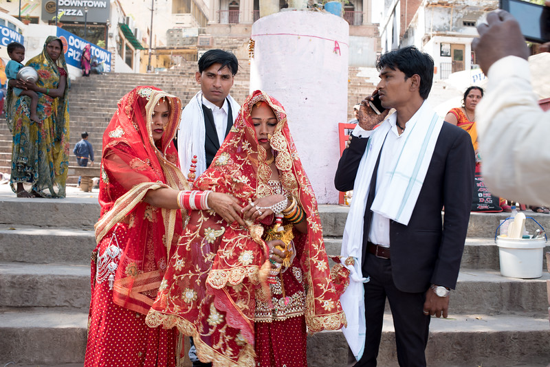 Two couples prepare for a blessing at the Ganges. Varanasi, India. March 3, 2018. Photo by Lorelei Trammell