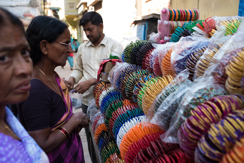 A woman looks at bangles for sale. Varanasi, India. March 11, 2018. Photo by Lorelei Trammell