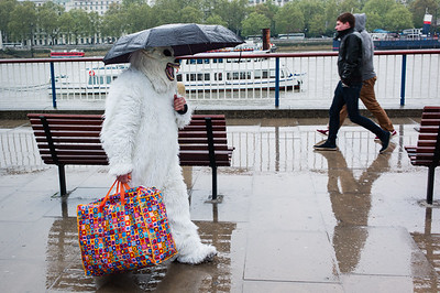 A street performer dressed as a Yeti, walks to work on London's Southbank during the rain.  May 07, 2012. Photo: Edmond Terakopian