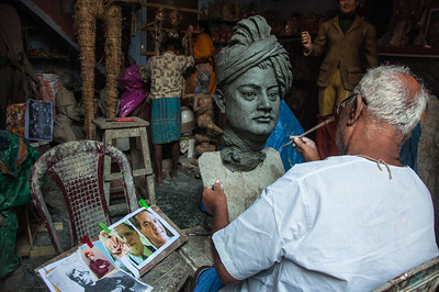 An Artist works on a bust of Swami Vivekananda at his studio in Kumartuli, Kolkata