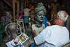 An Artist works on a bust of Swami Vivekananda at his studio in Kumartuli, Kolkata