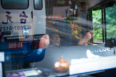 A napping bus driver in Taipei, Taiwan. November 20, 2017. Photo by Lorelei Trammell.