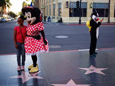 Cartoon characters interact with the tourists. Walk of fame, Hollywood Boulevard, Hollywood, California. January 16, 2014. Photo: Edmond Terakopian