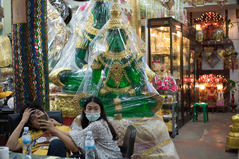 Employees at a store selling Buddha statues in Bangkok, Thailand. December 11, 2017. Photo by Lorelei Trammell