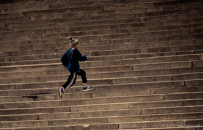 Young boy running up 'Rocky Steps' (where Sylvester Stallone ran up in the Rocky movie) - Philadelphia, U.S.A