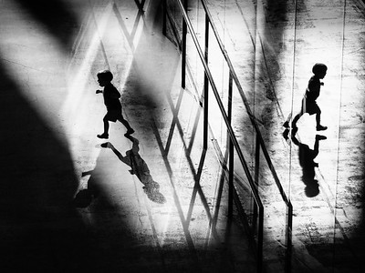 A child runs around whilst bathed in rays of sunlight in the turbine hall. Tate Modern, during a heat wave bank holiday. Bankside, London, UK. May 06, 2018. Photo: Edmond Terakopian