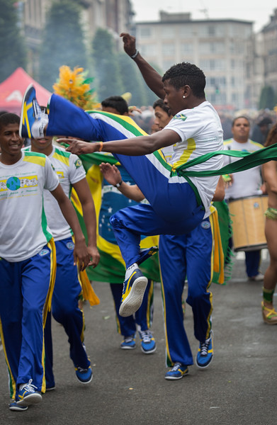 Young man jumping in the parade at the BorgerRio festival, Antwerp