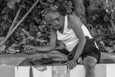 Old Thai man smoking a cigarette