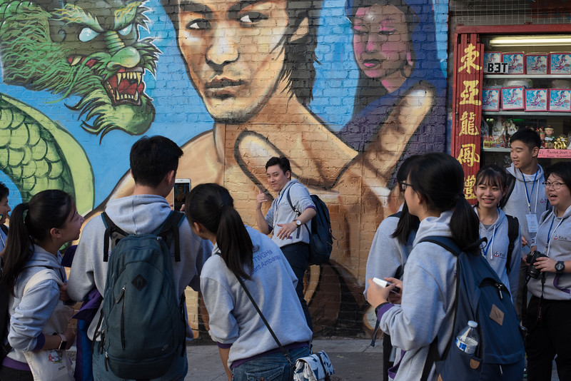 Students take pictures next to a Bruce Lee mural in San Francisco, California. October 23, 2017. Photo by Lorelei Trammell.