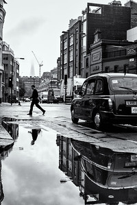 Pedestrian's getting wet on Central Stree, London EC1V. Heavy rain during a summer's day in London. August 13, 2015. Photo: Edmond Terakopian