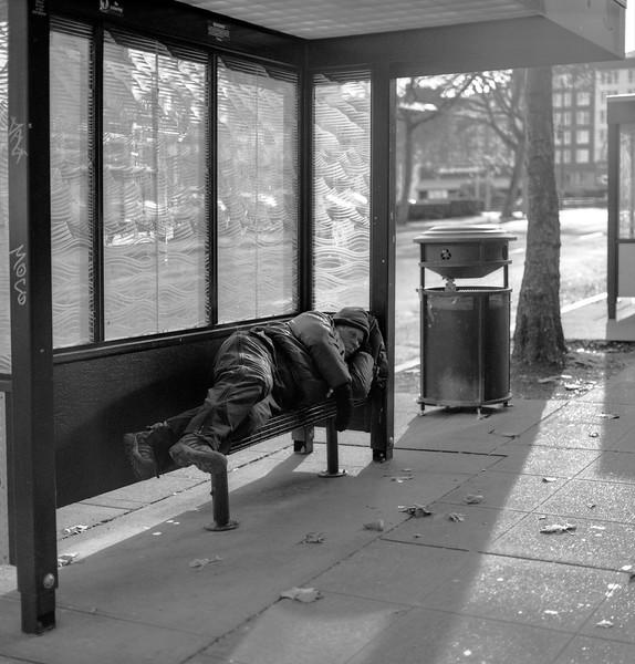 Sleeping at a bus stop