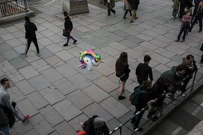 A unicorn balloon is carried by a young lady in London's South Bank. UK. April 10, 2018. Photo: Edmond Terakopian