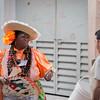 Woman Getting Passersby to Stop at La Bodeguita del Medio