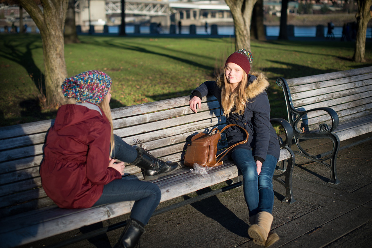 Two young ladies on a cold sunny day at the waterfront.  I'm amazed they could sit on that bench, it was pretty chilly. - Bob  - Nikon Df, AFS 50mm 1.4... Shot at F. 2.0
