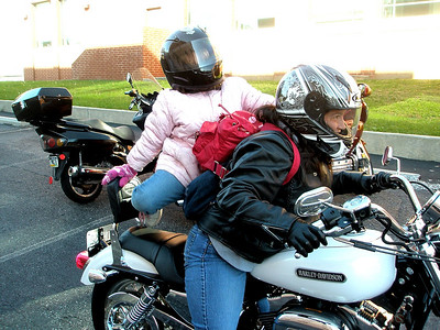 """You have to be agile to hop on the back of a motorcycle between the """"sissy bar"""" and Mom's backpack.  Luckily, she's only eight.  Either that or the most agile midget in Allentown."""