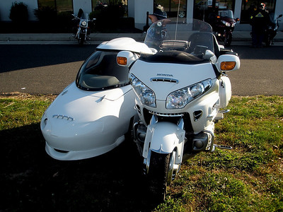 The passenger, with a completely enclosed sidecar, seems smarter than the rider on a frosty day like today.