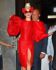 Non-Exclusive <br /> 2011 Sept 12 -  Lady Gaga walks out of a photoshoot with Annie Leibovitz wearing a dazzling red dress and high platform shoes in NYC.  Photo Credit Jackson Lee