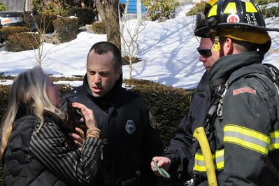 Cat number 2 gives Mommy a kiss while she thanks the police officer and firefighter who brought out the cats.