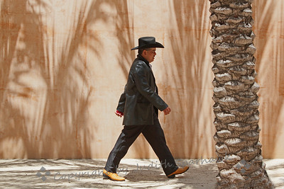 Caballero Walking ~ I liked the palm tree shadows on this wall at the cathedral, and felt it was a perfect spot to capture this man walking by.