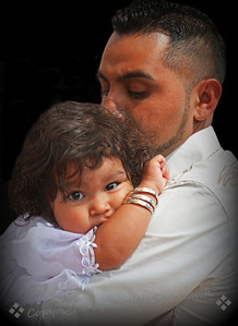 Baptismal Baby ~ Most weeks at the Catholic Church at Olvera Street, baptisms are held on Saturday mornings.  The boys and girls are dressed in white for the ceremonies.  This little girl, held in her father's arms, was just precious.