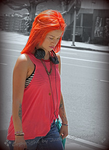 """Red"" ~ An eye-catching young woman walking along the street."