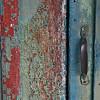 Doorhandle of abandoned house.