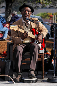 Ike Cosse is a local Blues singer and guitarist who occasionally plays the Marin County Farmer's Market.