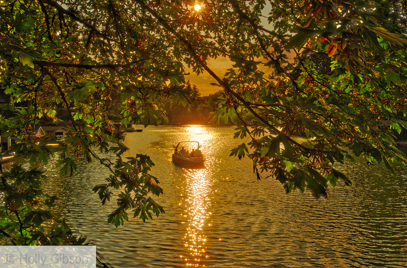 Boat on lake with evening sun