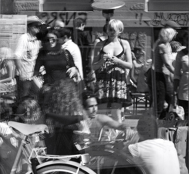 Streetlevels. Streetmarket in Nansensgade, Copenhagen. Summer 2008. Reflexions in window.