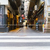 Early morning movement in narrow laneway of Degraves Street.