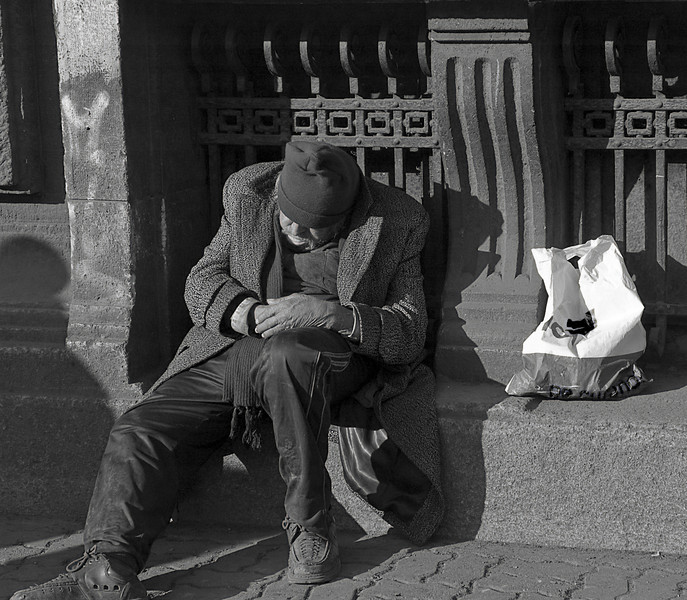 A nap in the sunshine, Bucharest, Romania (See Travel>Romania>Bucharest.)