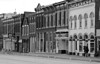 Night moves, very early morning, man and dog; Main Street, Keokuk, IA; September 9, 2001