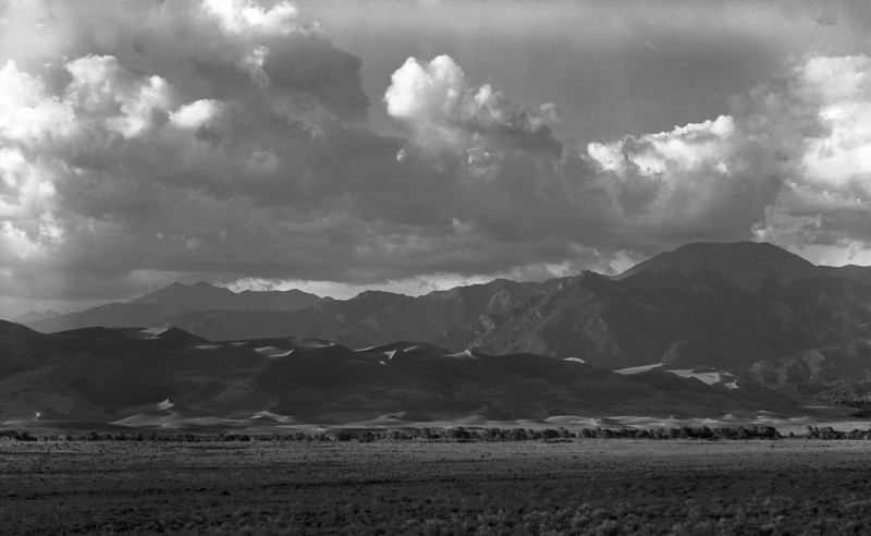 Not a street, I know, but neither was the Danube or the Ton Le Sap; an afternoon storm over Great Sand Dunes National Monument in southern Colorado, late summer 1981; shot on 4X5 Plus-X, scanned on an Epson Stylus Pro 750.