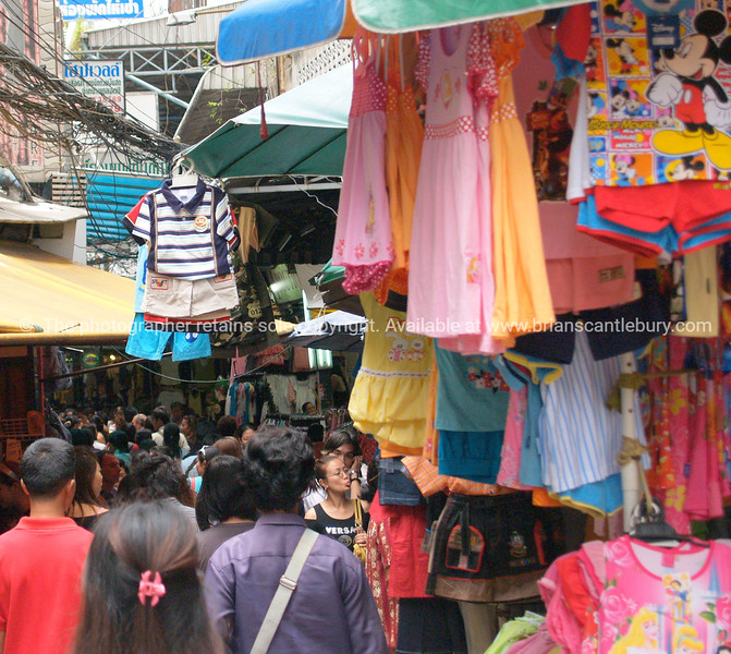 Bangkok street markets, people,products, hussle to sell and buy colourful clothing and fabrics. Thailand.