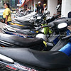 Bangkok street, row of parked motorcycles. Thailand.