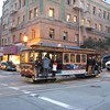 On steep hills, the cable cars stop at mid-intersection to pick up and drop off passengers.