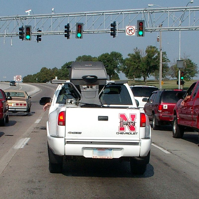 "<font size=""=3"">First Saturday of the college football season.  This fan has packed up his critical sporting equipment and is heading for the game.</font>"