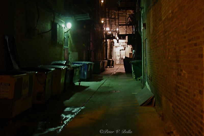 What lurks down dark alley ways at night?