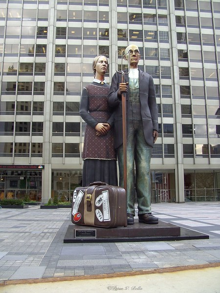 Sculpture rendition of Norman Rockwell's American Gothic in Pioneer Court.