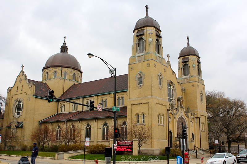 Our Lady of Lourdes Church at Leland and Ashland. The Church was originally built on the South East Corner. The whole building was moved across the street when Ashland Avenue was widened.