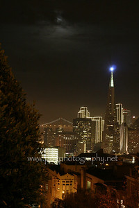 The financial district with the Transamerica pyramid lit on Christmas eve, as seen from Nob Hill.