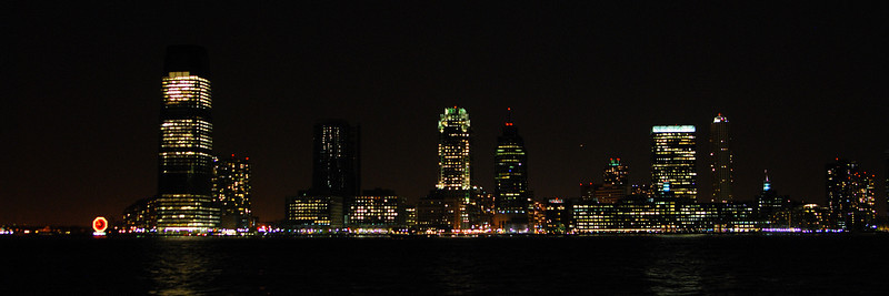 Looking across the Hudson river to New Jersey from Lower Manhattan.<br /> <br /> Nikon D80 with Tamron 28-75mm f/2.8 lens at iso400, 28mm, f/2.8, 1/6sec. Cropped & Brightened.
