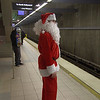 Los Angeles; Pub Crawl Santa waits for subway train