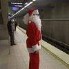 Los Angeles; Pub Crawl Santa waits for subway train